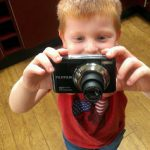 Little boy with his first camera