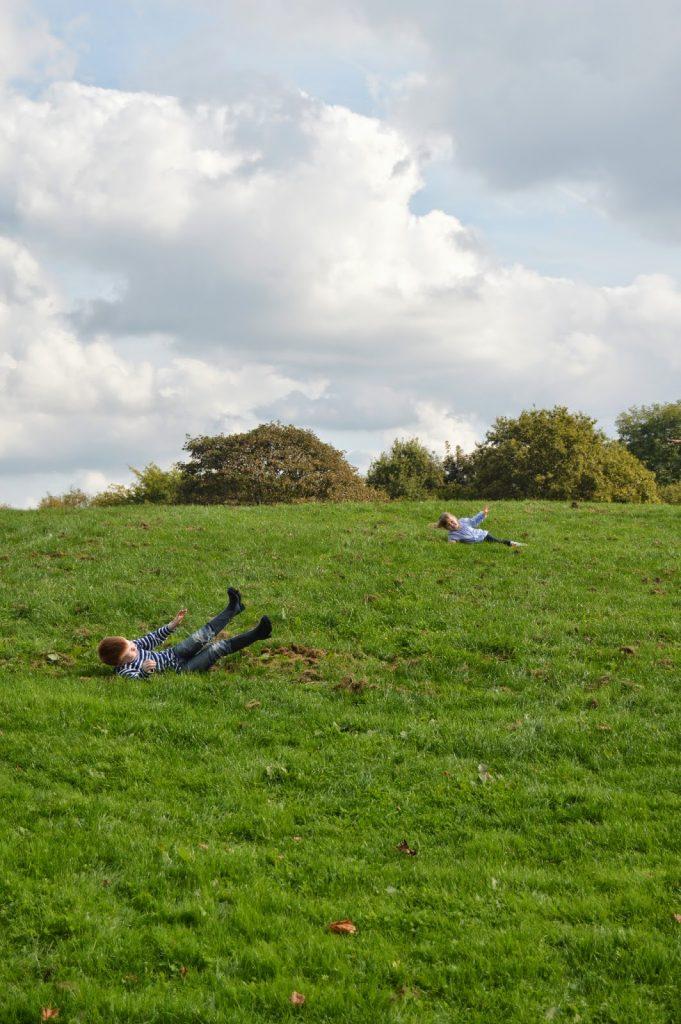 children rolling down hills