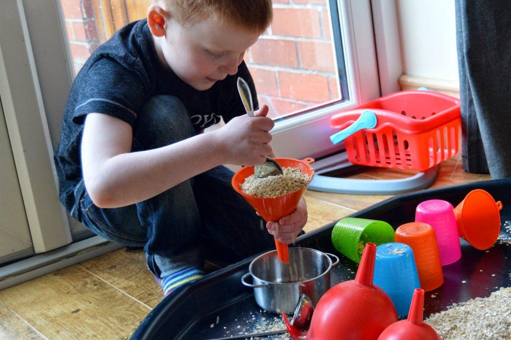pushing oats through a funnel on tuff spot