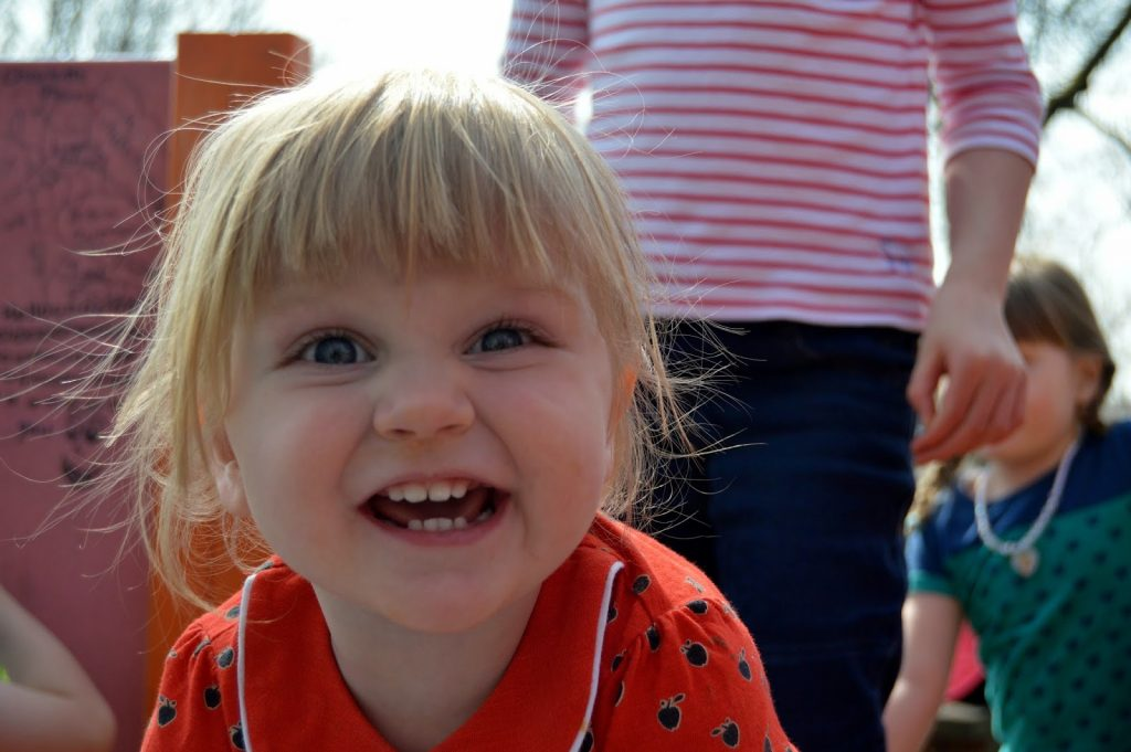 Toddler with a mouth full of teeth
