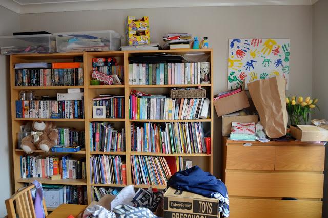 Cluttered Billy book shelves