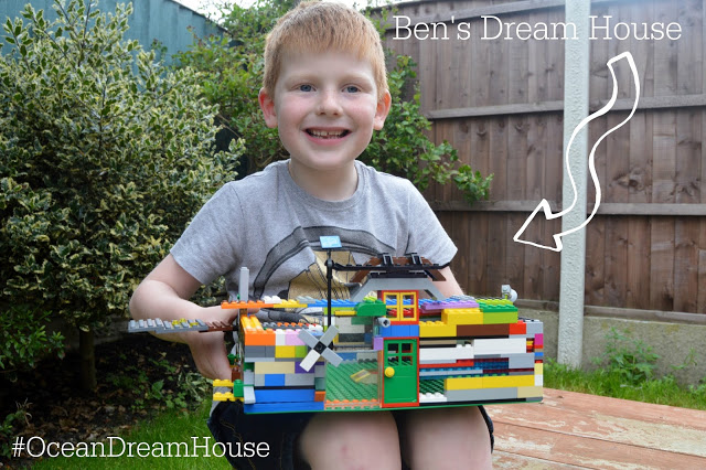 Little boy with his dream LEGO house