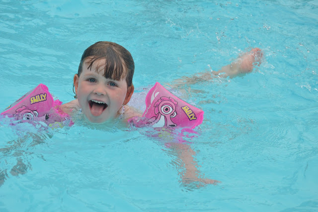 Chloe swimming with arm bands