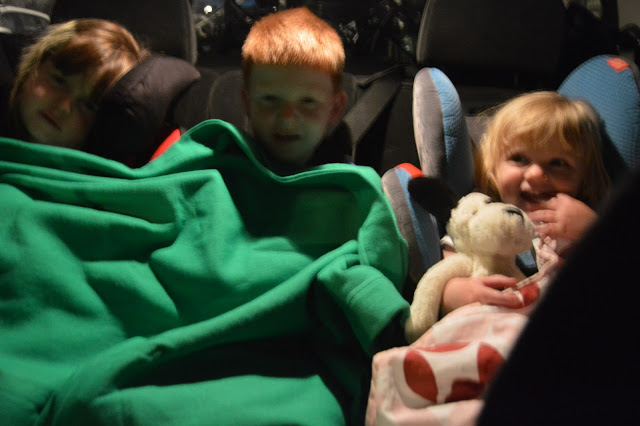 Kids in the back of the car, travelling at night