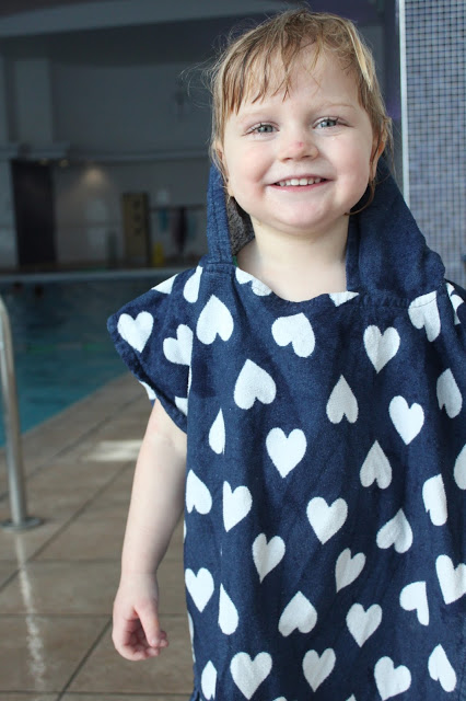 Little girl in towel smiling after her Puddle Ducks Kickers lesson