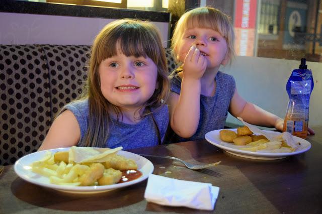 The girls enjoying their dinner at Peachy Keens, The Printworks