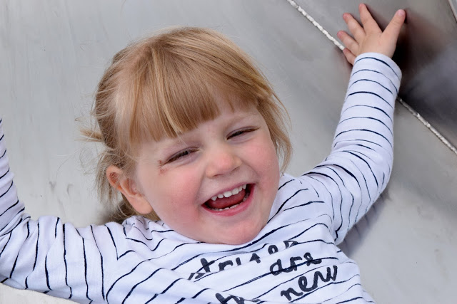 Toddler showing of a mouth full of milk teeth