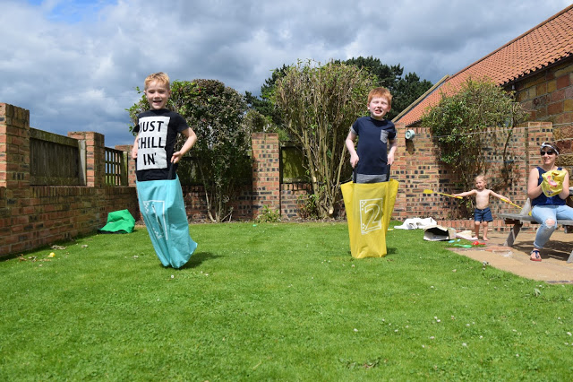 Low Moor Cottages - sack race in the garden