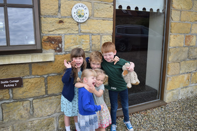 Low Moor Cottages - kids outside holiday cottage