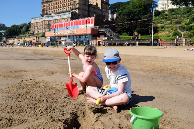 kids playing in the sand at Scarborough