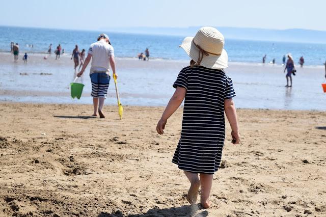 children walking to the sea