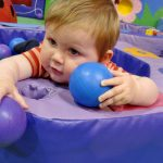 baby in a ball pool at soft play