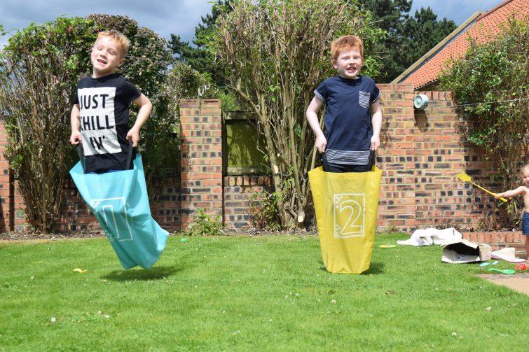 boys doing sack race