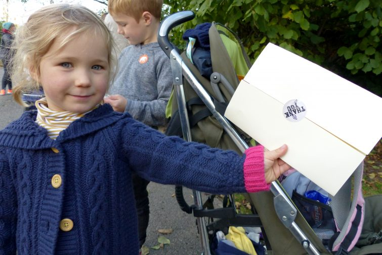 Erin shows her thank you message from the owls - The Enchantment of Chester Zoo