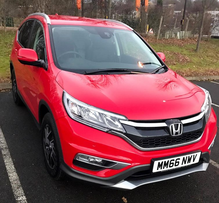 shiny new red Honda