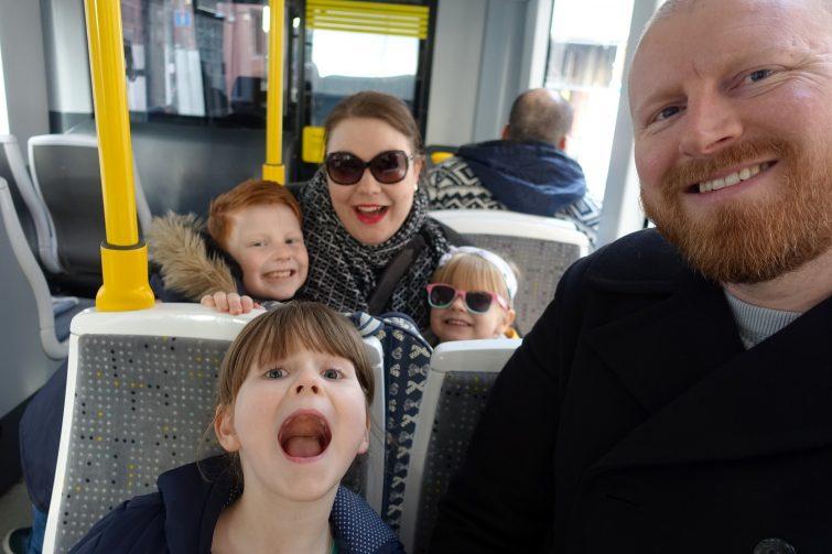Ordinary Moments - half term, family on tram
