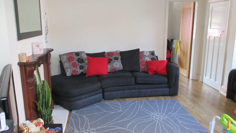 Old black chenille sofa