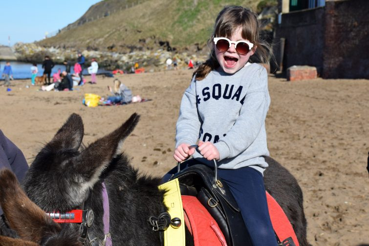 Chloe's first donkey ride of the year in Whitby