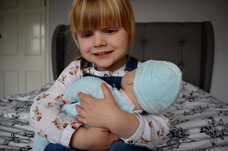 Cuddles with Baby Annabell's brother