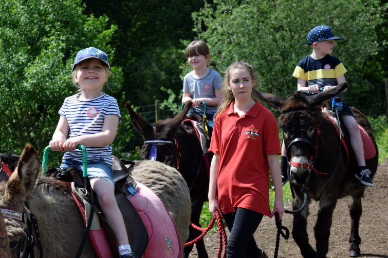 Riding donkeys at Smithills Open Farm with Piri Allergy