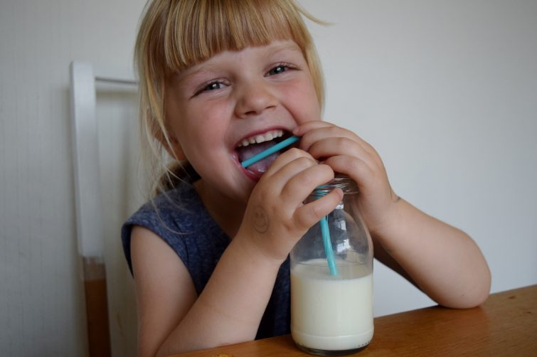 Little girl drinking Arla Organic Free Range milk