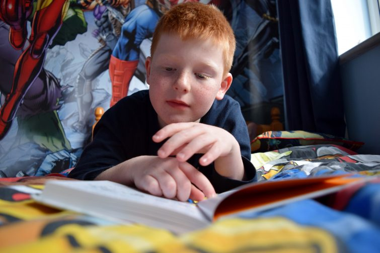 Boy reading #StartAStory Puffin Summer Reading campaign