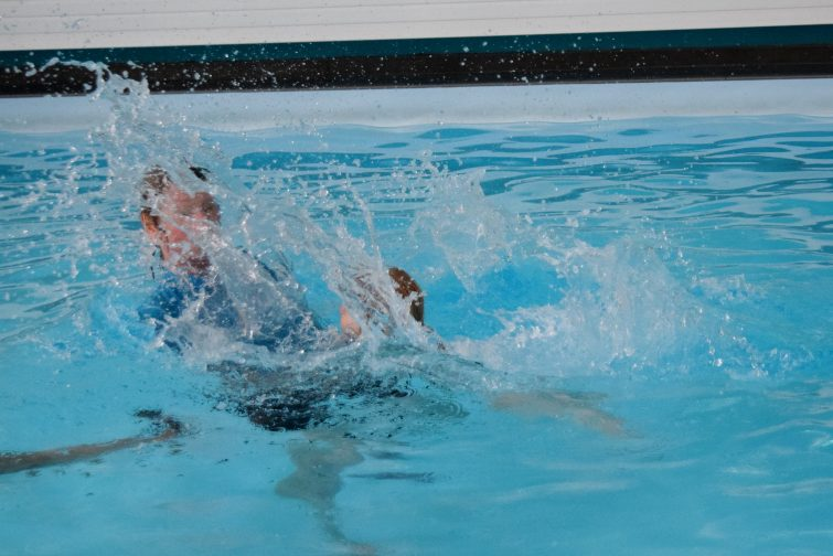 Little girl making a big splash in her swimming lesson