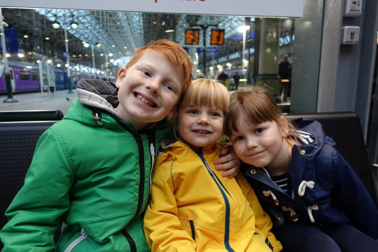 Kids waiting to get on the train at Manchester Piccadilly Station