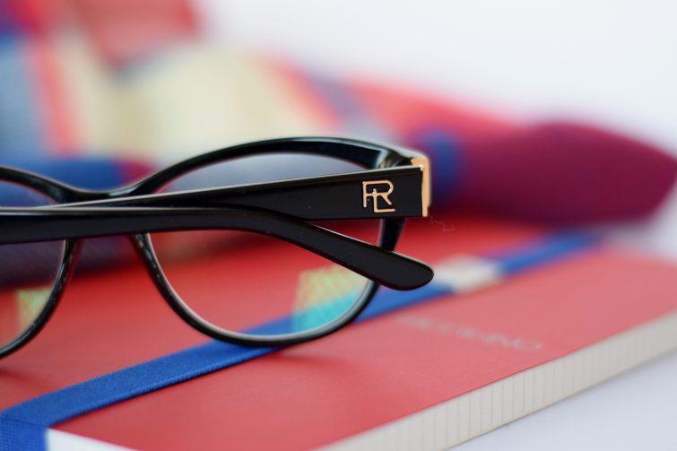 Discreet Ralph Lauren logo on black frame glasses