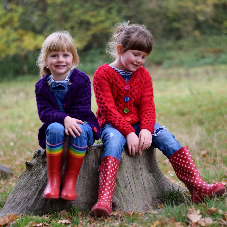 Girls in hand knitted cardigans