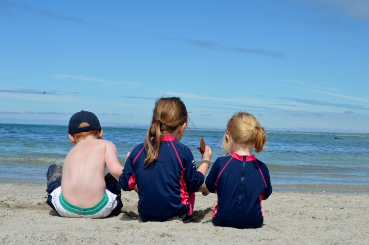 Kids on the beach in France- blue sky