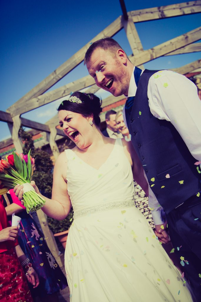 York Maze wedding - Bride and groom with confetti