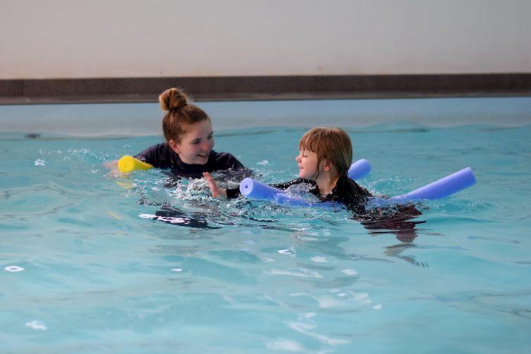 Puddle Ducks Swim Academy Pyjama Week - Swimming on woggles