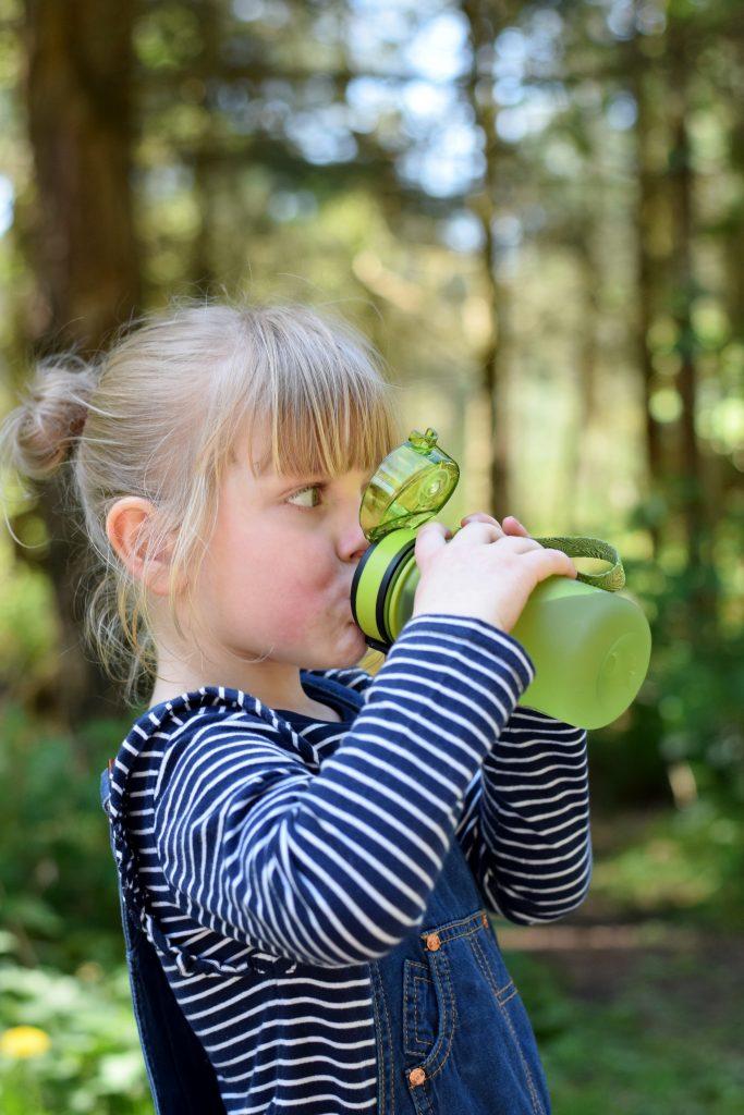 Little girl using reusable drink bottle