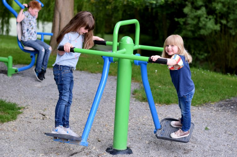 Children trying out the fitness equipment at Chateau de Lez Eaux campsite