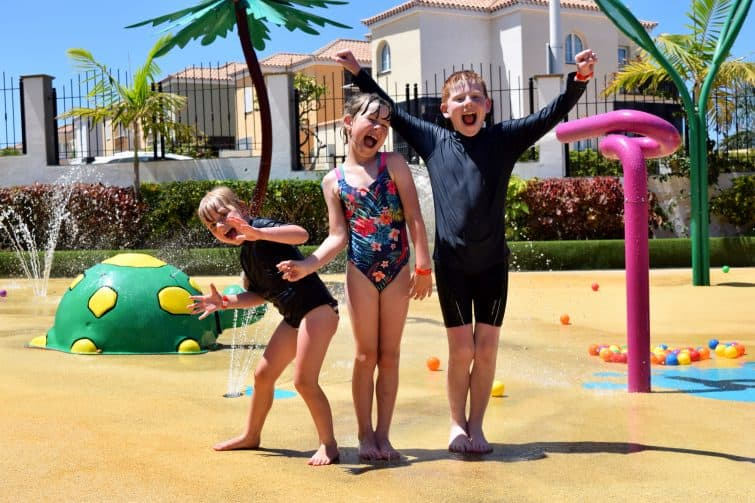 Siblings playing in the splash park at Holiday Village Tenerife