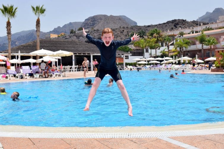Holiday Village Tenerife - boy jumping into pool