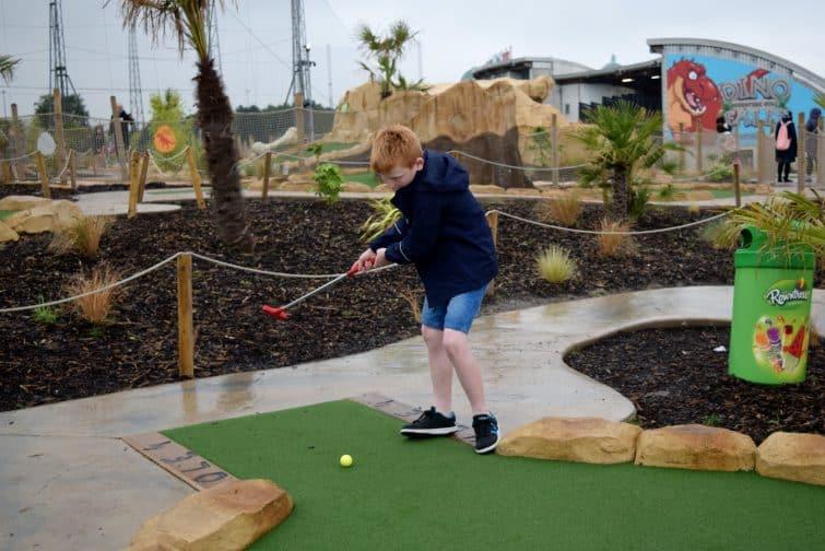 Trafford City Dinofalls Adventure golf - child playing crazy golf