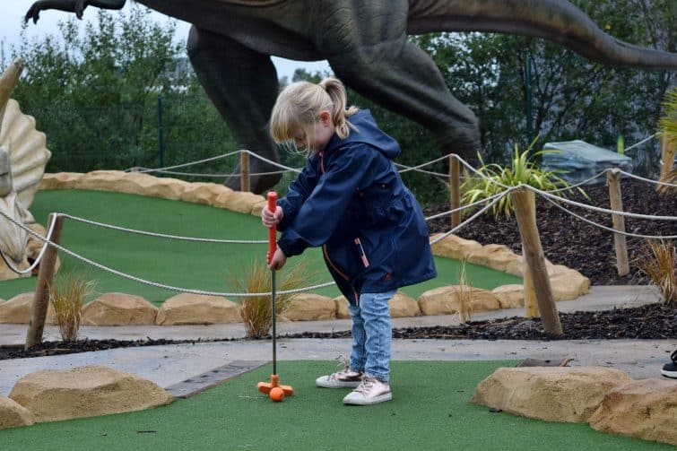 Trafford City Dinofalls Adventure Golf - how not to hold a golf club