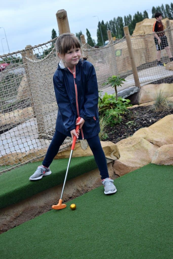 Trafford City Dinofalls Adventure golf - golf stance