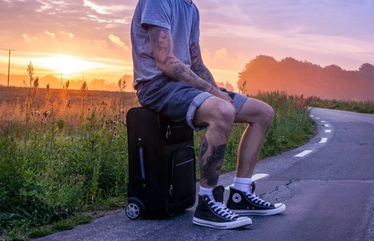 Traveller with suitcase