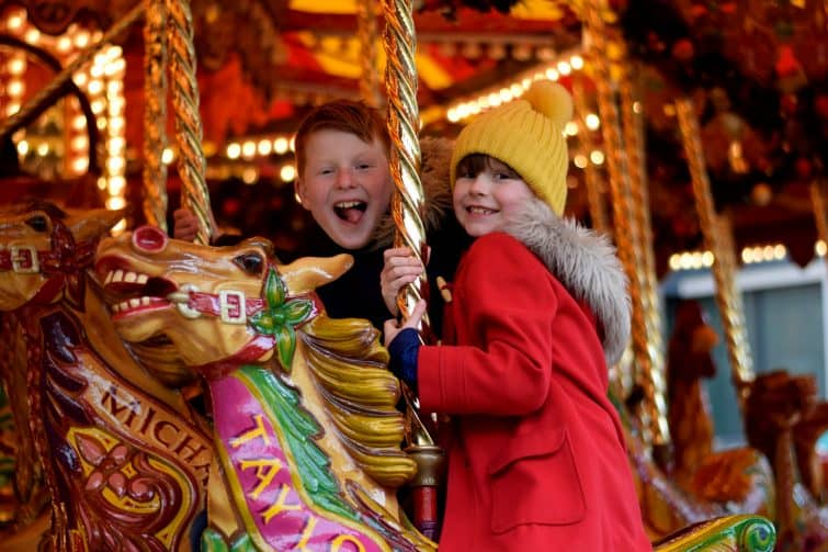 Children on carousel at Christmas Market