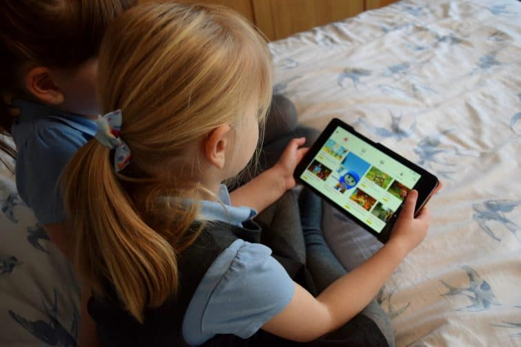 Girls using cbeebies app on tablet