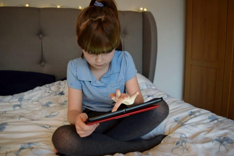 girl using tablet - Plusnet Nice Device