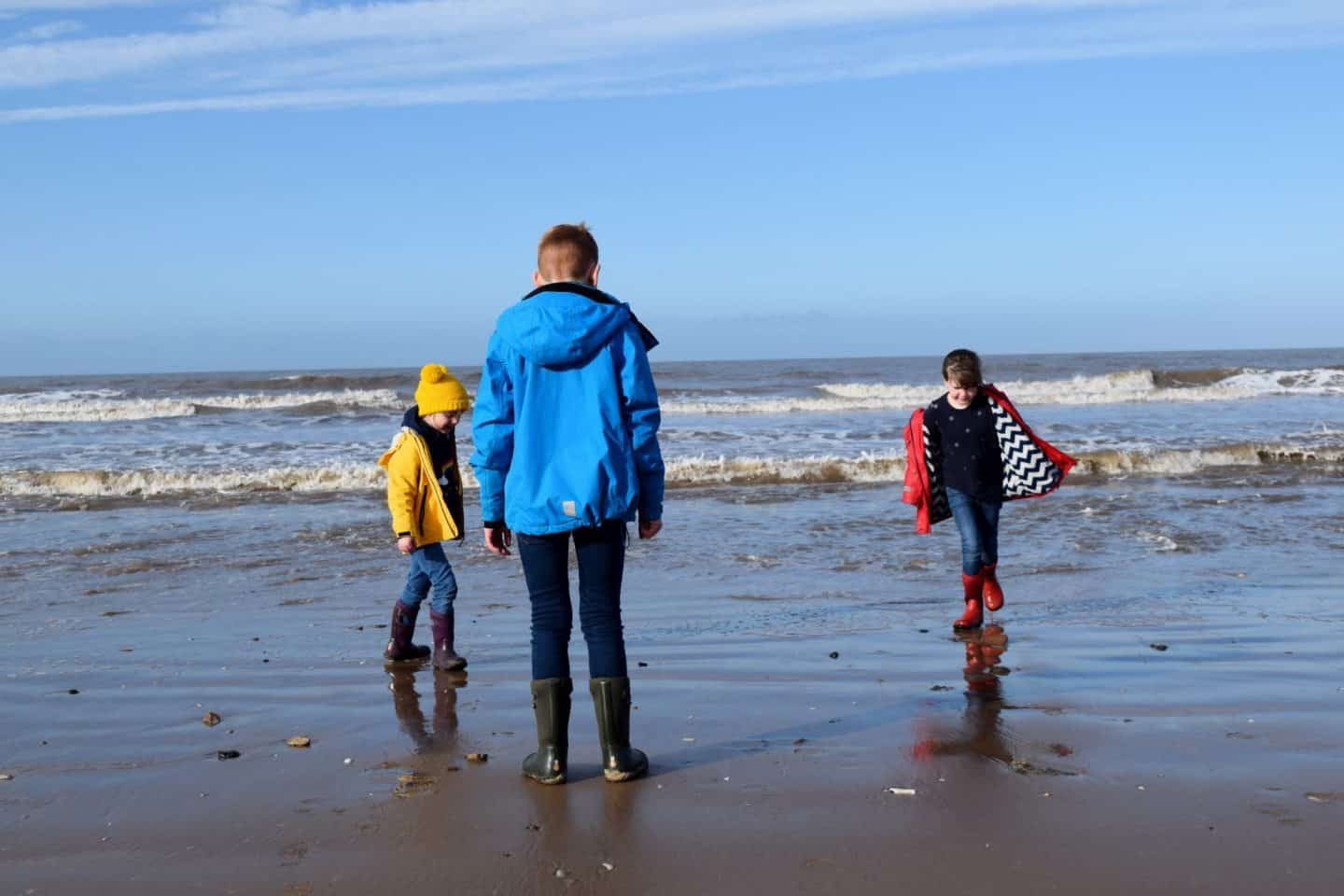 Children paddling in the sea at National Trust Formby