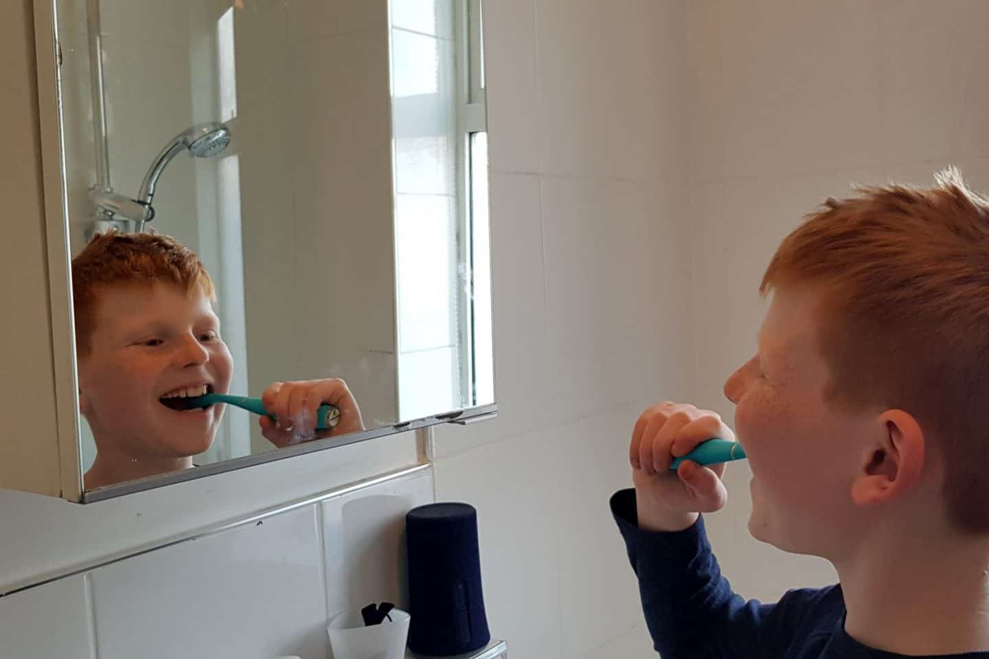 boy brushing teeth with silicone sonic toothbrush