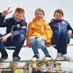 Siblings - May 2019 - kids sitting on the railings in Blackpool