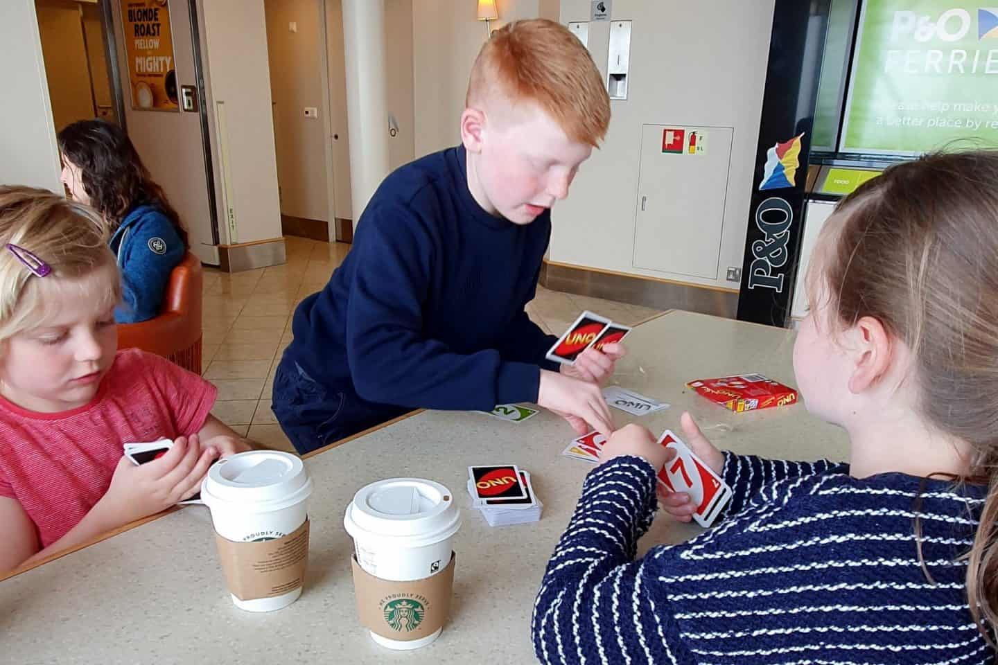 three children playing Uno on the ferry to France