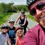 Family bike ride down the Canal du Midi in the South of France