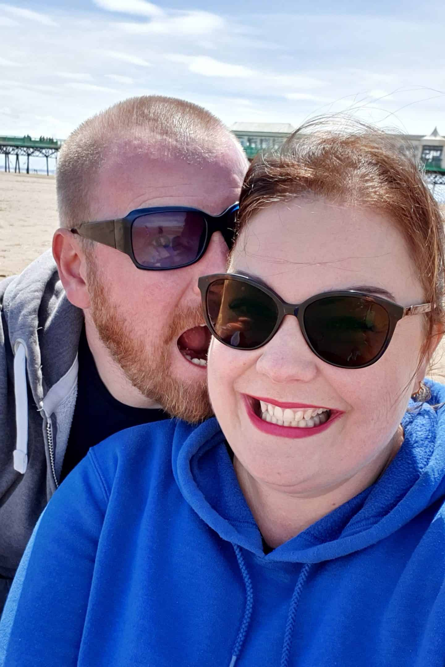 husband and wife on the beach in Lytham